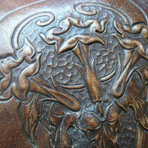 Antique carved leather handbag