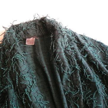 used green shaggy jacket & black pleated skirt