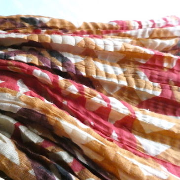 Used orange greek gauze style dress & 70's pale-tone horizontal stripe summer knit